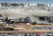 Những cơn sóng thần nhấn chìm các ngôi nhà ở Natori, tỉnh Miyagi.